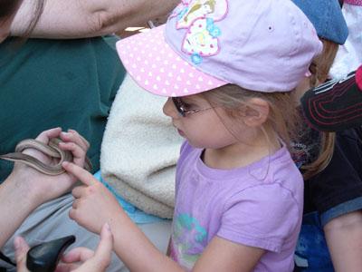 Tasha touching snake